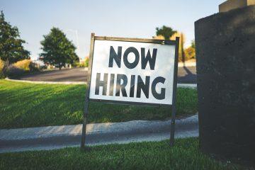 sign saying 'now hiring'