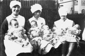 St Ultan's: Infants (l–r) Betty, George, Jack, Kate and Joseph with unnamed nurses, March 1929. (Teach Ultáin Infant Hospital)